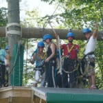 People preparing to zipline.